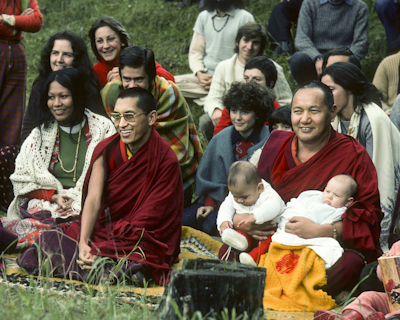 Lama Zopa Rinpoche and Lama Yeshe with babies and Italian students in Taceno, Italy, 1976. Photo: Peter Iseli.