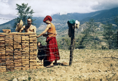 A student and monk Denis lay the first bricks at  Kopan Monastery, Nepal, 1971.