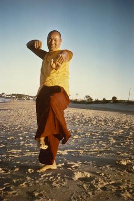 Lama Yeshe dancing/debating on the beach near Chenrezig Institute, Australia, 1975. Photo by Anila Ann.
