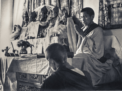 Lama Zopa Rinpoche teaching at the fourth course, Kopan Monastery, Nepal, 1973. Anila Ann is in the foreground.