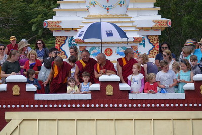 Lama Zopa Rinpoche releasing butterflies with children at Chenrezig Institute, Eudlo, Australia, September 2014. Photo: Ven. Roger Kunsang.