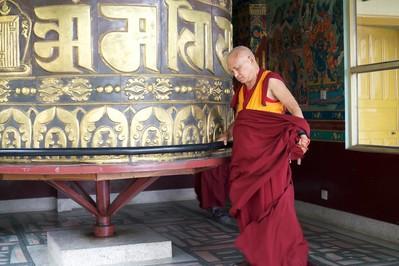 Lama Zopa Rinpoche turns the prayer wheel at Kopan Monastery, Nepal, December 2015. Photo: Bill Kane.