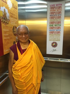 Rinpoche in the elevator at Amitabha Buddhist Centre, Singapore, March 2016. Photo: Roger Kunsang.