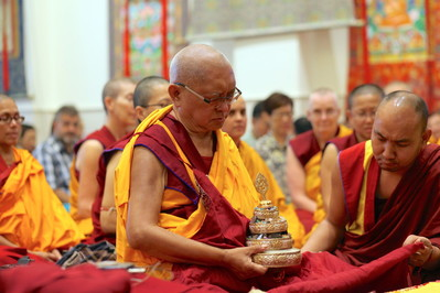 Rinpoche offers a mandala before initiation at ABC, Singapore, March 2016. Photo: Lobsang Sherab.