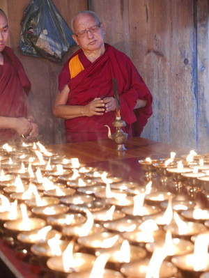 Lama Zopa Rinpoche offering butter lamps at Kyichu Lhakhang, a temple in Bhutan.  Photo: Roger Kunsang.