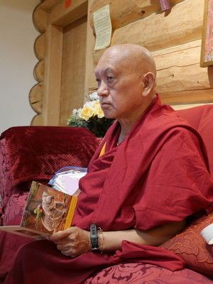 Lama Zopa Rinpoche writing cards at Buddha Amitabha Pure Land, USA, October 2016. Photo: Holly Ansett.