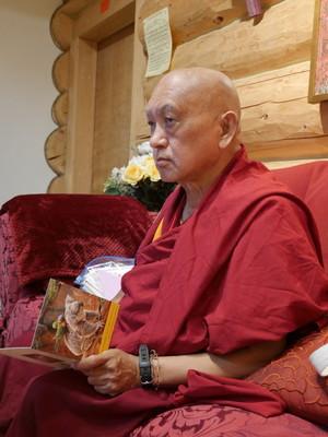 Lama Zopa Rinpoche writing cards at Buddha Amitabha Pure Land, USA, October 2016. Photo: Holly Ansett.