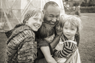Lama Yeshe with children, Festival Day at Manjushri Institute, 1979. Photo: Brian Beresford.