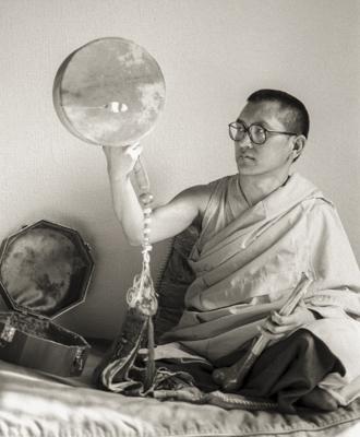 Lama Zopa Rinpoche playing the Chod damaru (drum) at Manjushri London (currently Jamyang Buddhist Centre), 1983. Photo by Robin Bath.