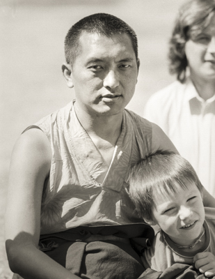 Lama Zopa Rinpoche relaxing with children and students at Waterlow Park, Highgate, London, 1983. Photo by Robin Bath.