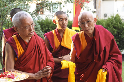 Lama Zopa Rinpoche blessing the Kalachakra Stupa at Kurukulla Center along with Geshe Tsulga and Geshe Tenley, Medford, Massachusetts, 2010. Photo by Wendy Cook.