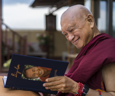 Lama Zopa Rinpoche enjoying his copy of Big Love, Kopan Monastery, Nepal, April 2020. Photo: Ven. Lobsang Sherab.