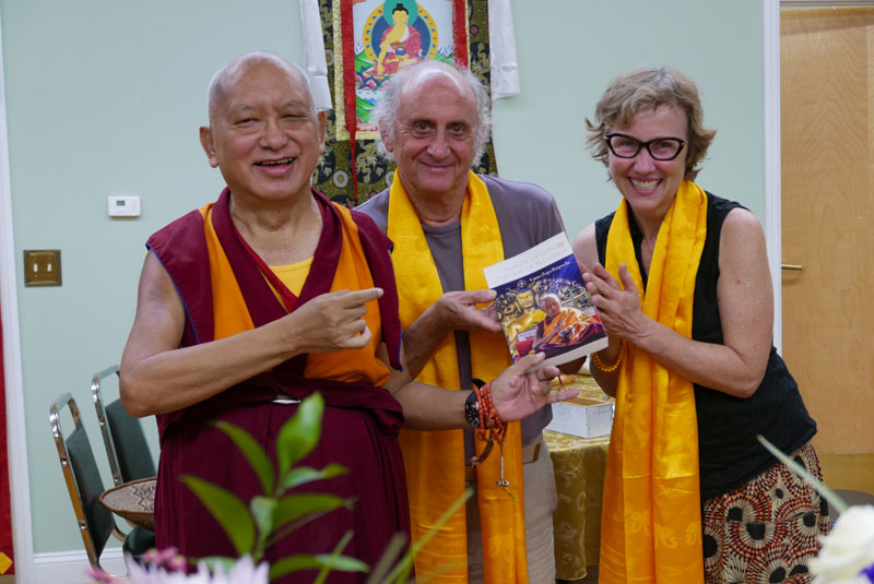 Nick Ribush and Wendy Cook present one of LYWA's latest publications to Lama Zopa Rinpoche, 2016. Photo: Ven. Roger Kunsang.