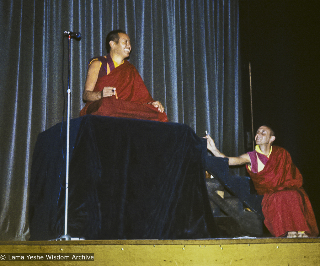 Lama Yeshe giving a public talk (with Nick Ribush at the right), Melbourne University, Australia, 1975.