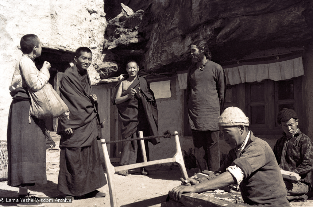 (15077_ng-1.psd) From the left: Tsultrim Allione, Lama Zopa Rinpoche, Lama Yeshe and Robert Sternfield with workers outside of the cave of the Lawudo Lama, Lawudo Retreat Centre, 1970. Photo by Terry Clifford.