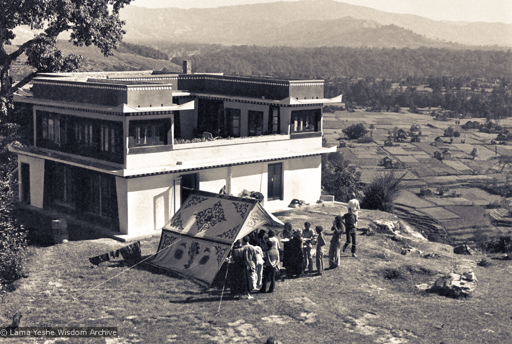 (15144_ng.psd) The construction of Kopan, second floor complete, rear view, 1972. Students and workers gather by the dining tent. Kopan Monastery, built in Nepal, is the first major teaching center founded by Lama Yeshe and Lama Zopa Rinpoche.