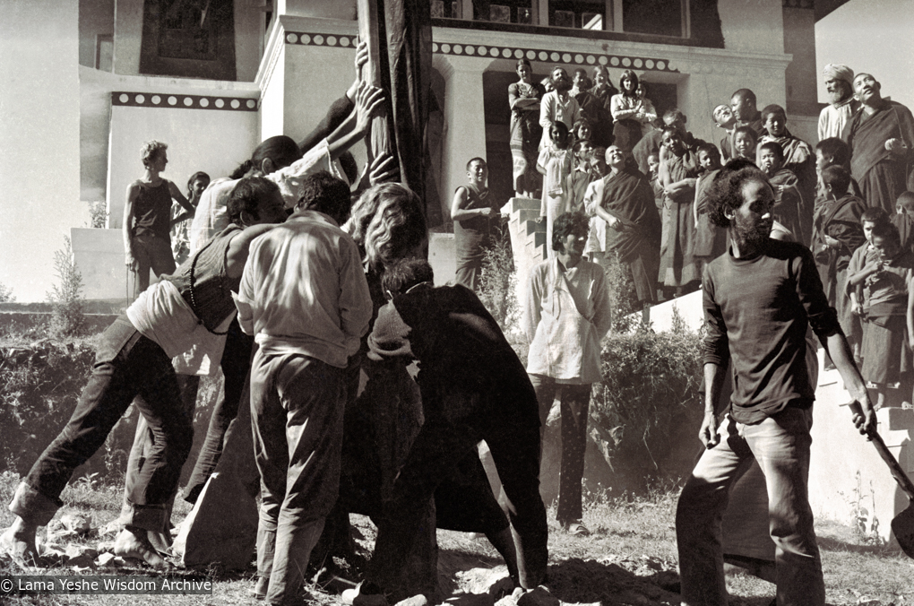 (15155_ng.psd) Raising the prayer flag pole at Kopan Monastery, Nepal, 1972. In attendance are some Mount Everest Center monks and students from the third Kopan course. Nick Ribush, an early student of the Lamas, is at the front right.