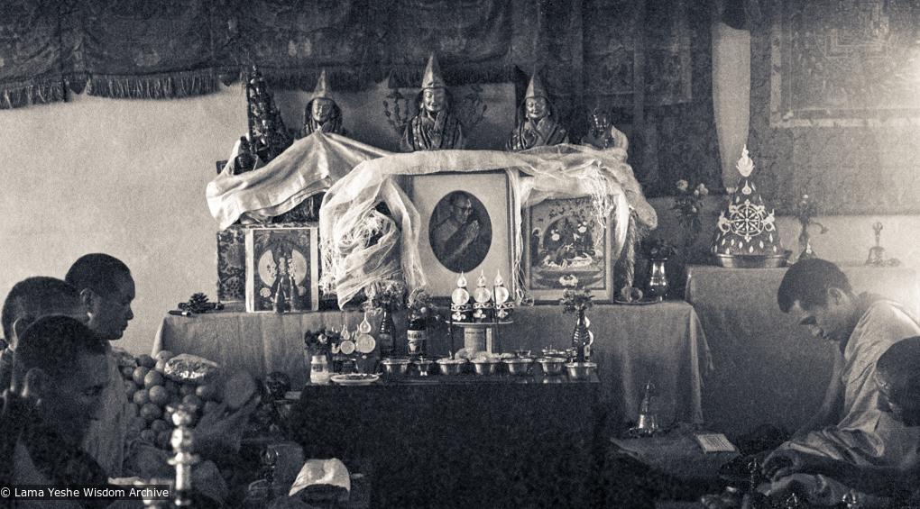 (15159_ng.psd) 1972, installing the portrait of His Holiness the Dalai Lama in the Kopan Gompa. Lama Yeshe and Lama Zopa with other monks offering prayers.