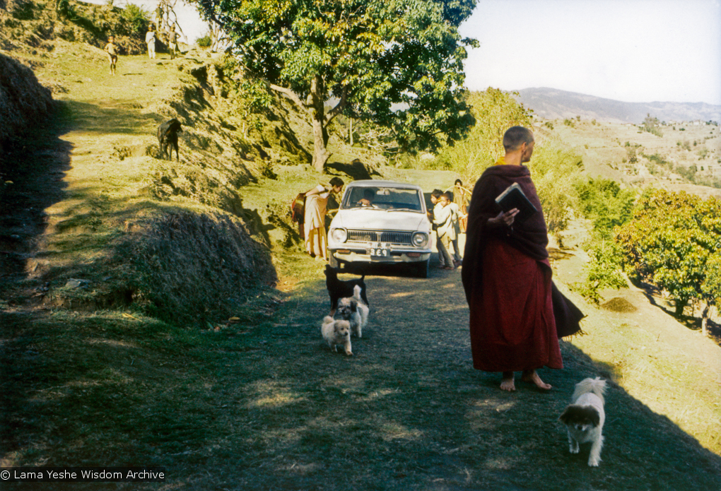(15175_pr.psd) Zina Rachevsky walking uphill to the Kopan Monastery, 1972. Zina was an eccentric Russian-American socialite, the child of a Russian expat father and a German-Jewish mother, who became the Lamas' first Western student in 1966, and who insisted that the Lamas start to teach courses on Buddhism for Westerners. She helped the Lamas found what would later come to be known as Kopan Monastery in Nepal. (Photo used with permission of the estate of Zina Rachevsky.)
