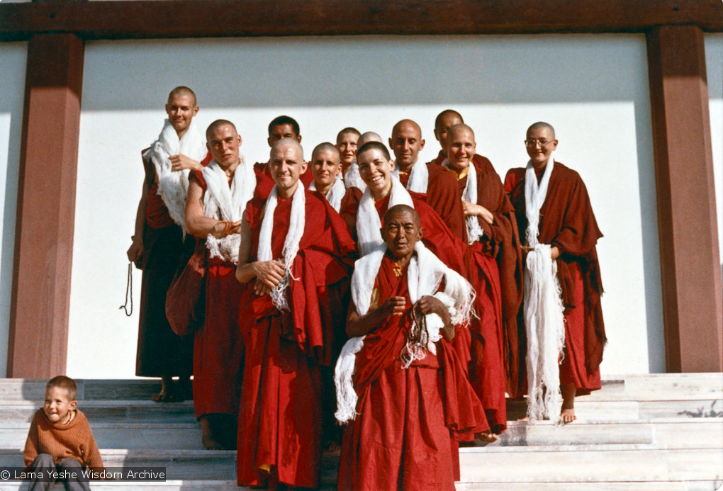 (15469_ud.psd) Ordination photo of western Dharma students including Gareth Sparham, Marcel Bertels, Ama-la (Mother of Lama Zopa), Nick Ribush, Nicole Couture, Thubten Pemo (Linda Grossman), Thubten Pende (Jim Dougherty), Ursula Bernis, Thubten Wongmo  (Feather Meston), Yeshe Khadro (Marie Obst) and Daja Meston (Thubten Wangchuk), son of Wongmo, on the steps to the left. It is interesting to note that Lama Yeshe and Lama Zopa Rinpoche are both in the photo, but hiding behind the heads of the new monastics. Bodhgaya, India, 1974.