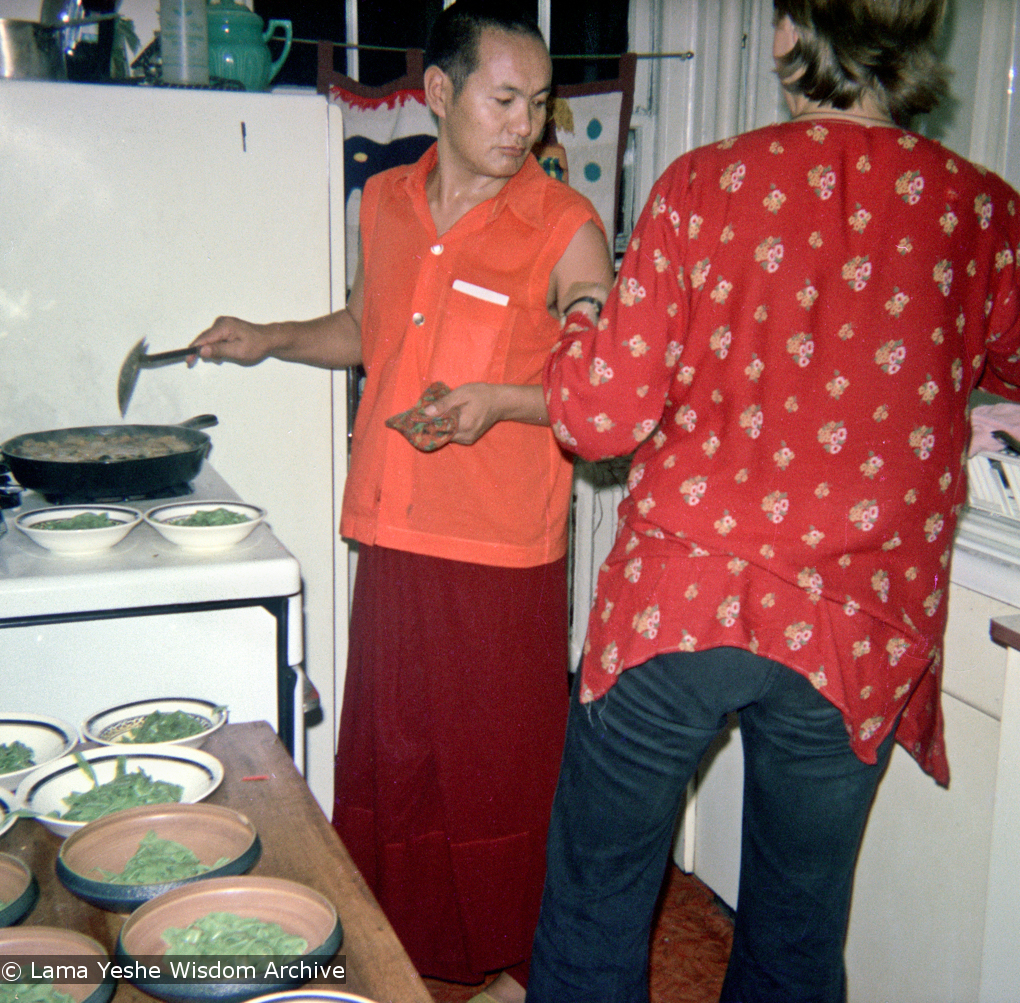 (15846_ng.psd) Lama Yeshe cooking, New York City, 1974. Photo shows Lama and Sylvia (maiden name unknown, later married Bo Sax) in the kitchen. In July 1974, the lamas and Mummy Max arrived in New York City to begin the first international teaching tour of Lama Yeshe and Lama Zopa Rinpoche. They stayed at the apartment of Lynda Millspaugh on the Upper West side of Manhattan.