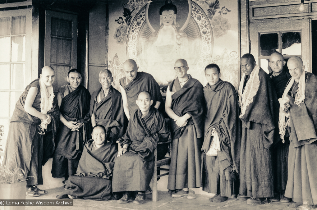 (15904_ud.tif) Ordination group, Tushita, 1975. From left to right: Bonnie Rothenberg, Geshe Jampa Wangdu, unknown monk, John Feuille, Dieter Kratzer, unknown monk, Jampa Konchog (Yogi), Bruno LeGuevel, and Jeffery Webster in the back row, with Lama Yeshe in front (seated)and Lati Rinpoche (seated in chair). On the morning of March 12th with Lati Rinpoche presiding, five new monks and one nun were ordained into the International Mahayana Institute. Tushita Retreat Centre, Dharamsala, India, 1975.
