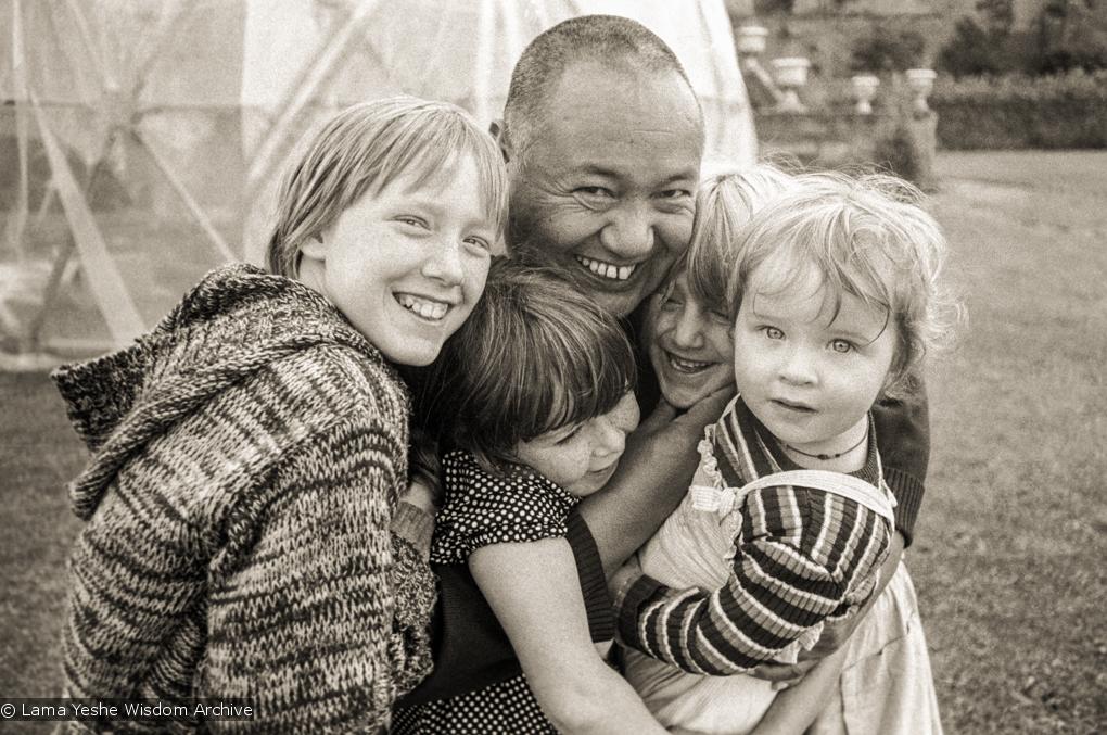 (20893_ng-1.psd) Lama Yeshe with children, Festival Day at Manjushri Institute, 1979. Brian Beresford (photographer)