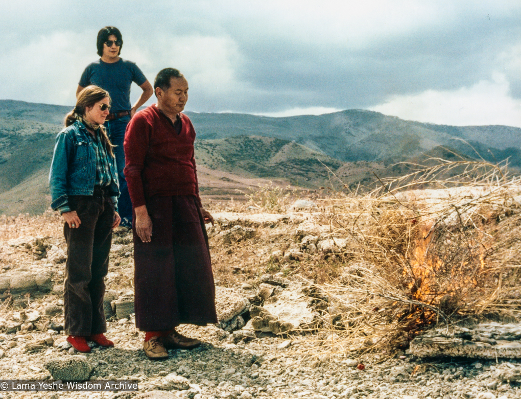 (39468_pr-3.tif) Lama Yeshe doing puja with Paula Chichester and LaNada Boyer (Warjack) at Pyramid Lake after the Grizzly Lodge Course, 1980. Carol Fields (donor)