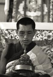 Lama Zopa Rinpoche doing mandala offering during the 9th Meditation Course, Kopan Monastery, Nepal, 1976.