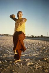 Lama Yeshe dancing/debating on the beach near Chenrezig Institute, Australia, 1975. Photo by Anila Ann.