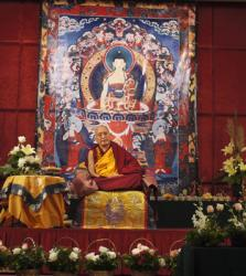 Lama Zopa Rinpoche teaching in Singapore, 2010. Photo by Ven. Thubten Kunsang (Henri Lopez).