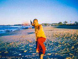 (00079_ud.jpg) Lama Yeshe dancing/debating on the beach after the month-long course at Chenrezig Institute, Australia, 1975. Photo by Anila Ann.