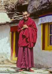 (04210_sl-6.psd) Lama Zopa Rinpoche in front of the Lawudo Lama cave, Lawudo Retreat Center, Nepal, 1978. Ueli Minder (photographer)