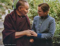 """(05379_pr-3.psd) Lama Yeshe with Vicki Mackenzie, Kopan Monastery, Nepal, 1983. Vicki Mackenzie: It was December 1983 after Lama's last  teaching in Kopan, and was taken as he stepped outside the tent, after his last teachings on Bodhicitta.  He was spent, so ill. I took his hands. He asked what he could do for me. I was aghast.""""No, Lama, what can I do for you?,"""" I replied. Lama thought for a while and said """"Give my love to all my brothers and sisters in England."""""""