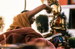 (06482_sl.JPG) Lama Zopa Rinpoche painting Tara, Kopan Monastery, Nepal, 1976. Lama Yeshe sent Max Mathews to buy a large Tara statue in Kathmandu, which was eventually placed in a glass-fronted house on a pedestal overlooking a triangular pond that was built under the ancient bodhi tree in front of the gompa, Kopan Monastery, Nepal. Photo by Peter Iseli.