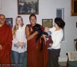(07647_pr-2.psd) Lama Yeshe with the Ribush family, 1975. From left: Nick Ribush, Alison Ribush, Lama Yeshe holding Bobik, and Beatrice Ribush holding Kalu. Melbourne, Australia, 1975. Photo by Dorian Ribush.