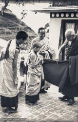 (08570_ng-3.JPG) Zong Rinpoche shows Losang Tseten how to wear a zen as Lama Yeshe and Lama Zopa Rinpoche look on, Kopan Monastery, 1974.