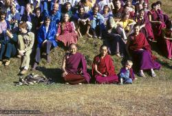 (09466_sl-2.psd) Lama Yeshe and Lama Zopa Rinpoche in a group photo from the 8th Meditation Course at Kopan Monastery, Nepal, 1975. In the center is Lama Yeshe and Lama Zopa Rinpoche, with Thor Kolb next to him, then Marcel Bertels seated above. To the left of Marcel in the yellow is Wendy Finster.