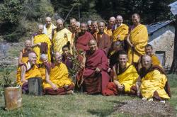 (09493_sl.JPG) Ordination group with Lama Yeshe, 1976. Front row: George Churinoff (Karin Valham behind him), Elisabeth Drukier, Dieter Kratzer, (Losang Nyima behind him), Lama Yeshe, Thubten Pende (Jim Dougherty), Steve Malasky (Steve Pearl). Gareth Sparham and Marcel Bertels are behind Pende and Steve. Back row (standing): Margaret McAndrew, Adrian Feldmann (Thubten Gyatso), Scott Brusso, Ursula Bernis, Wendy Finster, unknown tibetan monk, in back Angeles de la Torre, Jeffery Webster, unknown tibetan monk, Peter Kedge, Roger Wheeler, John Feuille.