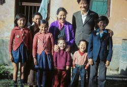 (09626_sl.JPG) Jampa Trinley with his wife, Ngawang, their family and Daja Meston (Thubten Wangchuk) in the front, at their house in Kathmandu, Nepal, 1975. Front row, left to right: Wangmo, Daja Meston (Thubten Wangchuk), Tsewang, Tashi. Back row, left to right: Nyidro, Auntie Tham Chola, Ngawang, Jampa Trinley.   Kelsang Puntsog Rinpoche, the son of Lama Yeshe's old friend Jampa Trinley, was later recognized to be the reincarnation of Geshe Ngawang Gendun, one of Lama's teachers.