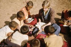 (09645_sl.JPG) Connie Miller, an American student, arrived on Christmas Day 1975 to stay at Kopan. These photos show her  teaching English to the Mount Everest Center students, Kopan Monastery, Nepal, 1976.