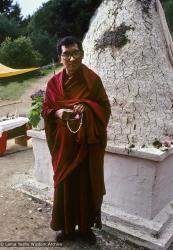 (09988_sl-3.psd) Lama Zopa Rinpoche at the cremation stupa of Lama Yeshe, Vajrapani Institute, California, 1984. Ricardo de Aratanha (photographer)