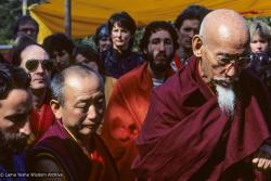 (10041_sl-3.JPG) Chuck Thomas, Nick Ribush, Geshe Lobsang Gyatso with Zong Rinpoche at the cremation of Lama Yeshe, Vajrapani Institute, California, 1984. Ricardo de Aratanha (photographer)
