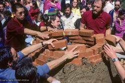 (10051_sl-3.JPG) Sealing the cremation stupa of Lama Yeshe, Vajrapani Institute, California, 1984. Photo includes Tenzin Wangchuk, John Jackson, Bill Kane, and Chuck Thomas. Ricardo de Aratanha (photographer)
