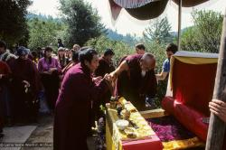 (10063_sl.JPG) Zong Rinpoche attended to by Geshe Gyeltsen at the cremation of Lama Yeshe at Vajrapani Institute, California in March of 1984. Photo by Ricardo de Aratanha.