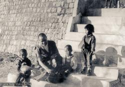 "(11715_ud-3.psd) Lama Yeshe with Jhamba Drolkar (Lama's ""daughter"" at TCV) and two Nepalese boys on the front steps of Tibetan Children's Village, Dharamsala, India, 1973."