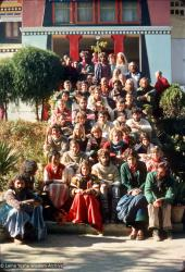 (12741_sl-2.psd) Group sitting with Lama Yeshe on the monastery steps, Kopan Monastery, Nepal, 1976. Photo includes Bill Kane, Harry Sutton, Dharmawati, Steve Ginsburg, Roger Munroe, George Churinoff, Xavi Alongina, Bruce Heavenor, Tom & Shirley Begley, Hester Roos, and Thubten Wongmo.