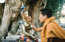 (12926_sl.tif) Lama Zopa Rinpoche painting Tara, Kopan Monastery, Nepal, 1976. Lama Yeshe sent Max Mathews to buy a large Tara statue in Kathmandu, which was eventually placed in a glass-fronted house on a pedestal overlooking a triangular pond that was built under the ancient bodhi tree in front of the gompa, Kopan Monastery, Nepal. Photo by Peter Iseli.