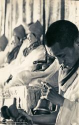 (13300_pr-2.psd) Lama Zopa Rinpoche doing puja (spiritual practice) during the Fourth Meditation Course, Kopan Monastery, Nepal, 1973. Photo by Brian Beresford.
