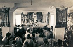 (13302_pr-2.psd) Lama Zopa Rinpoche doing puja (spiritual practice) during the Fourth Meditation Course, Kopan Monastery, Nepal, 1973. Photo by Brian Beresford.